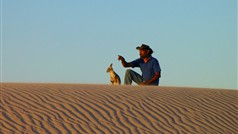 Tour Guide Graham Clarke, on the sand dunes at Mungo.