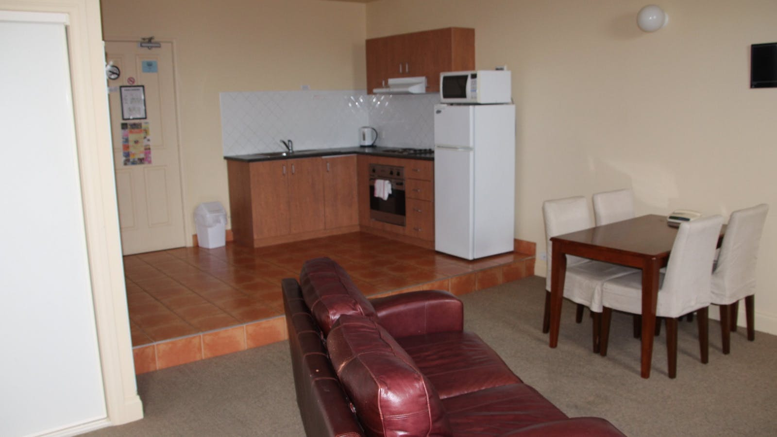Deluxe Studio sitting and Kitchen area