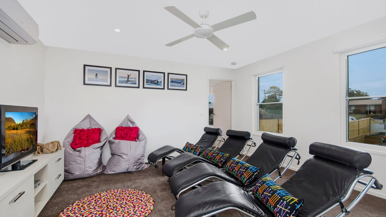 Bell Air Ocean Grove. Upstairs living with funky leather recliners