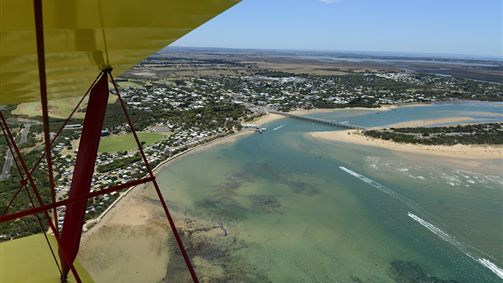 Tiger Moth World adventure flight passing Barwon Heads