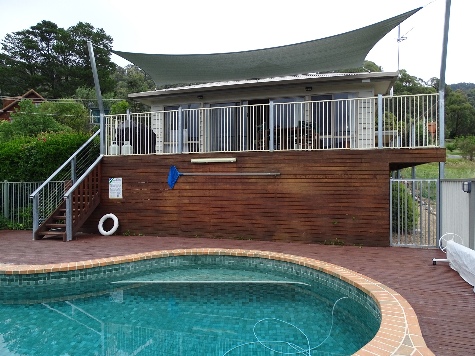 Main house/sunshade/spacious decking overlooking glorious pool and mountain views