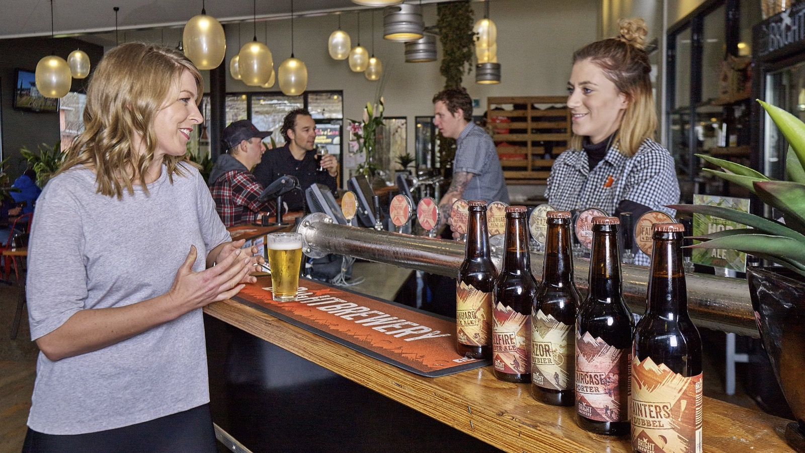 Customers ordering beer at Bright Brewery's bar