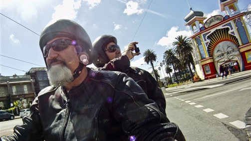 Get the best photographs of Melbourne while seated on the back of a Harley Davidson motorcycle