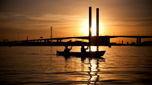 Sunset behind the Bolte Bridge on the Moonlight Kayak Tour
