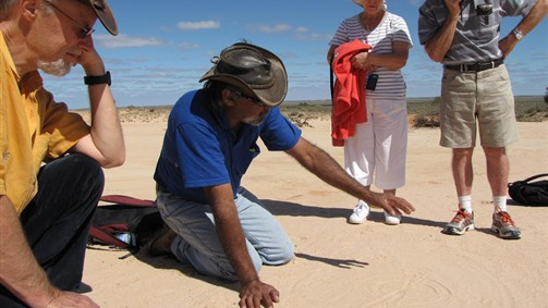 Aboriginal Guide Graham explaining history in the sand. Mungo Outback Journey