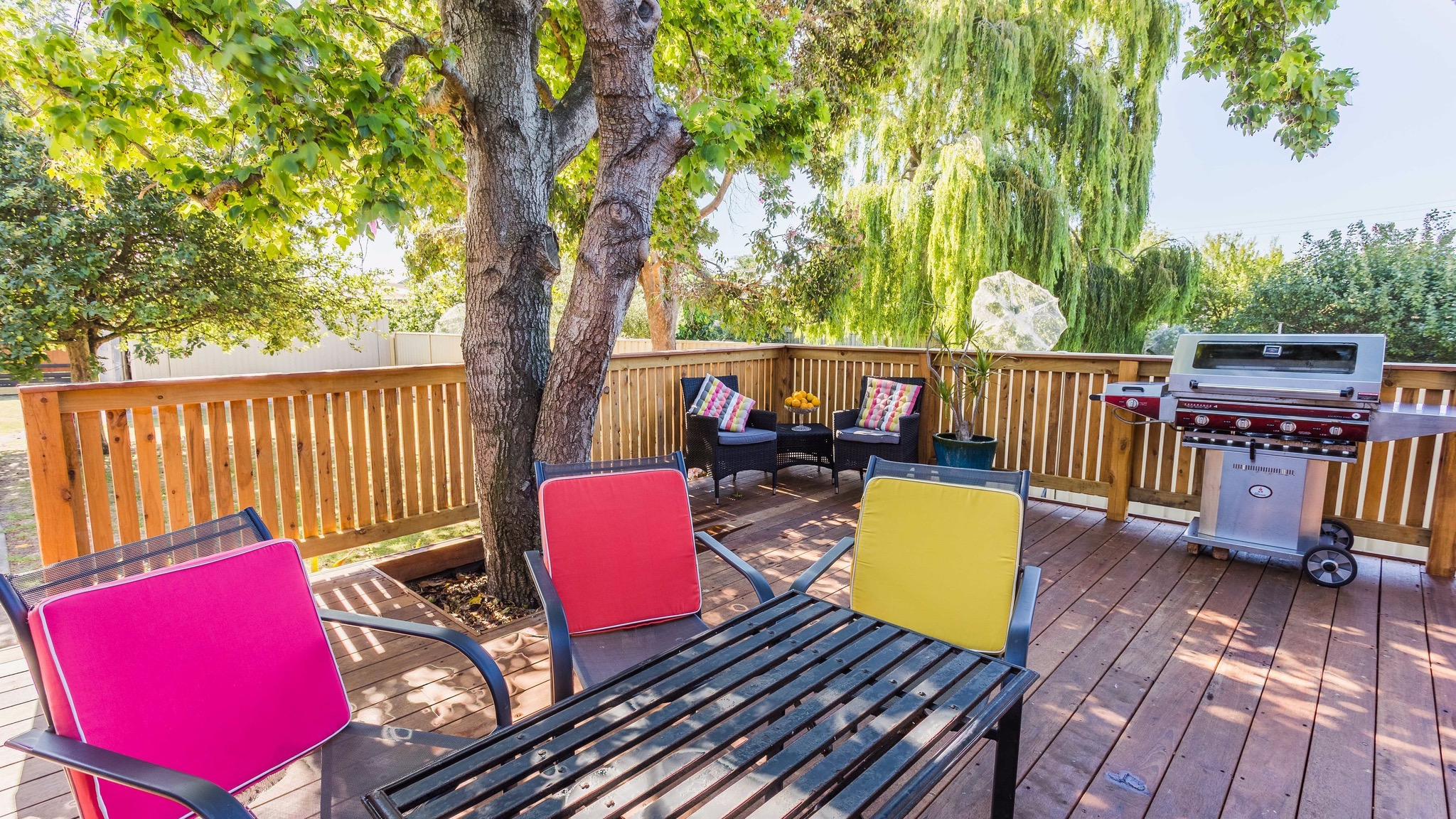 Huge shady back yard, super large deck with BBQ