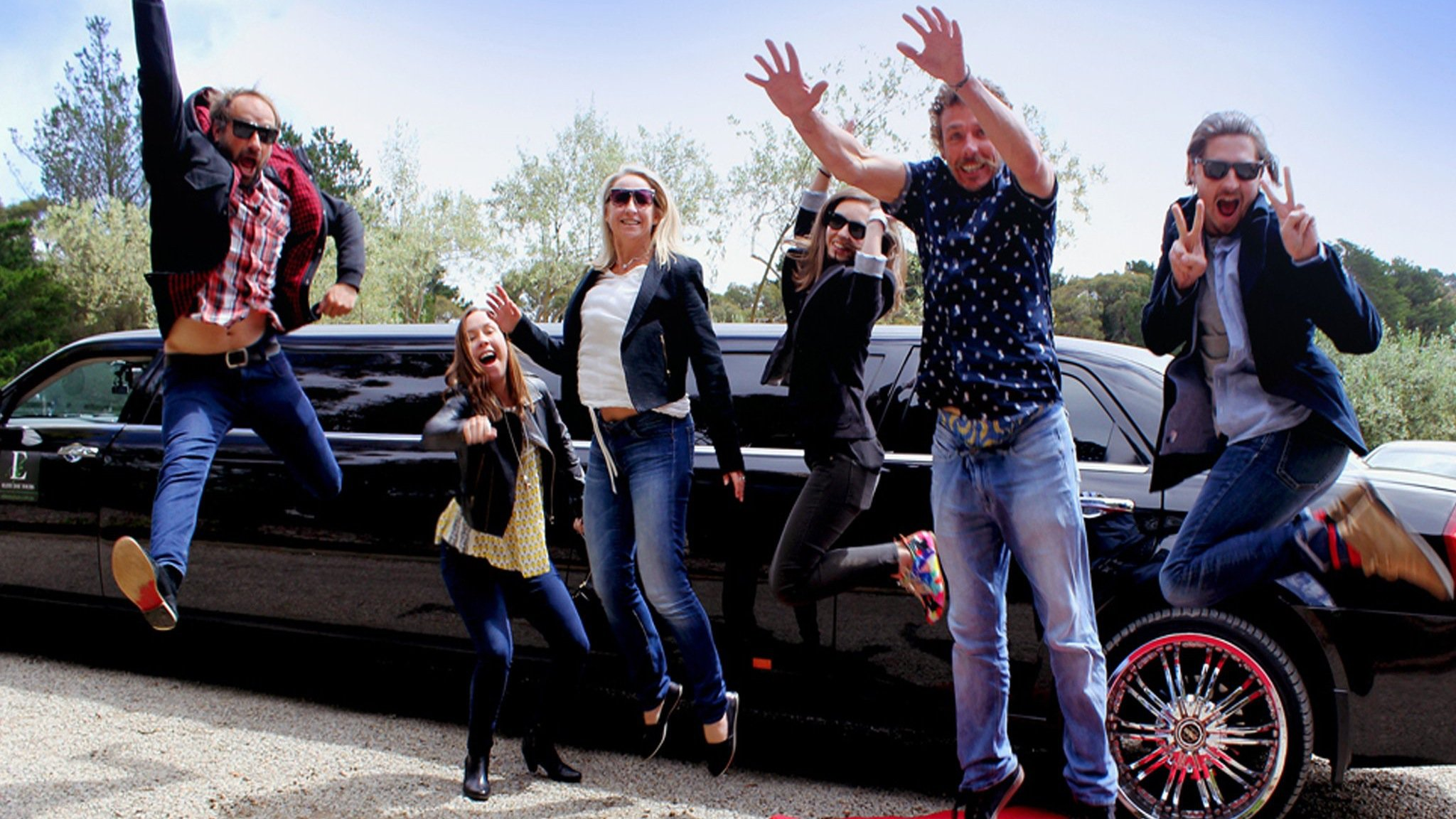 Groups of 6 or more travel in a stretch limousine with sparkling wine