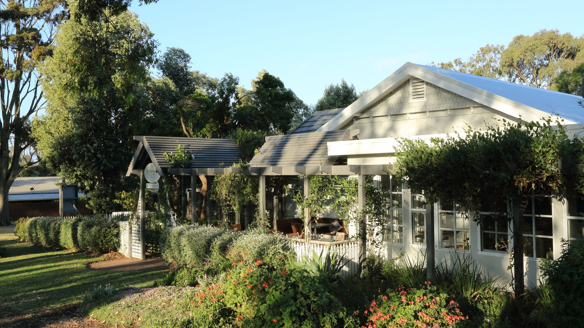 Holmwood Guesthouse surrounded by tall gum trees