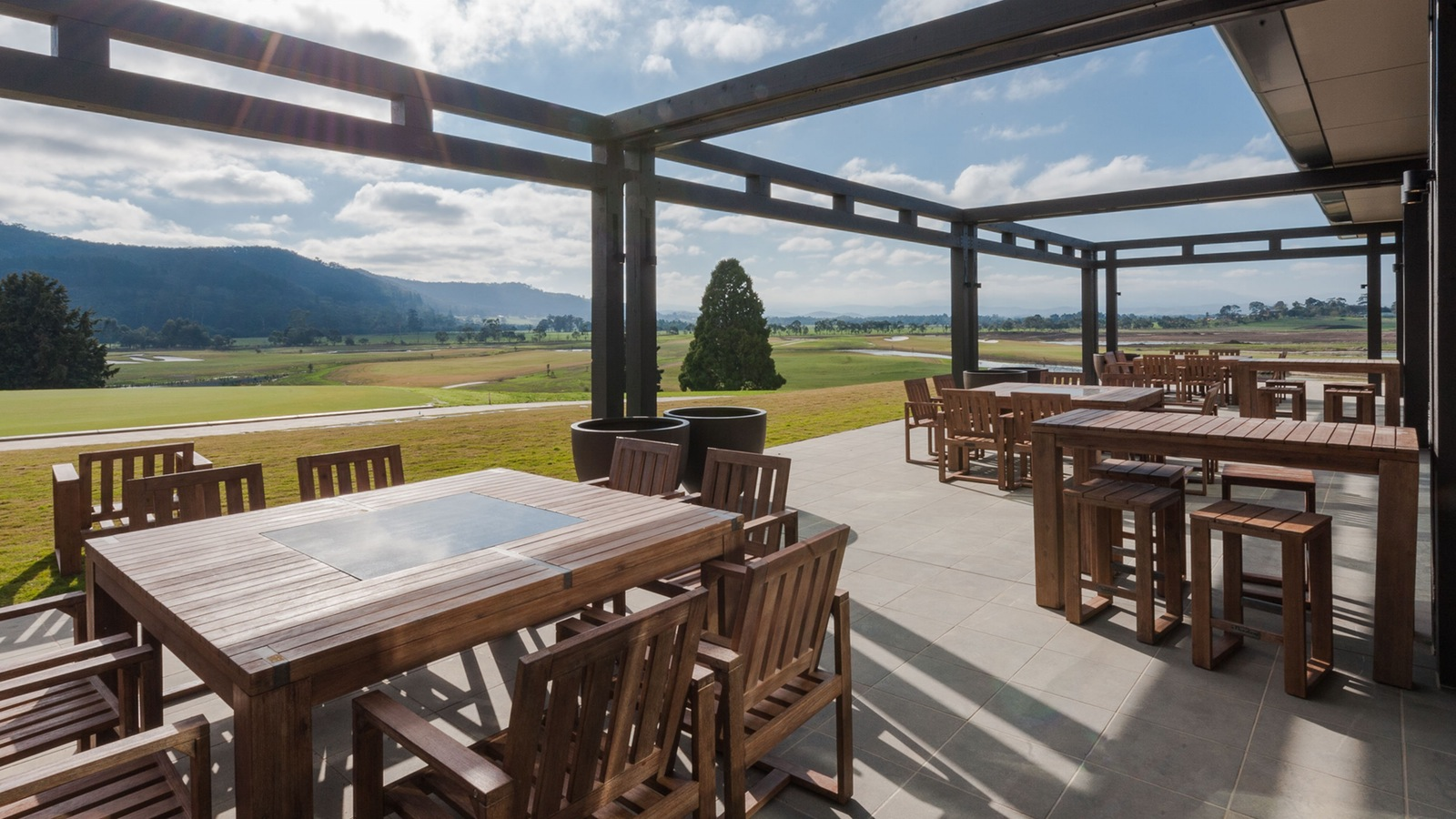 Outdoor terrace lounge overlooking The Eastern Golf Club
