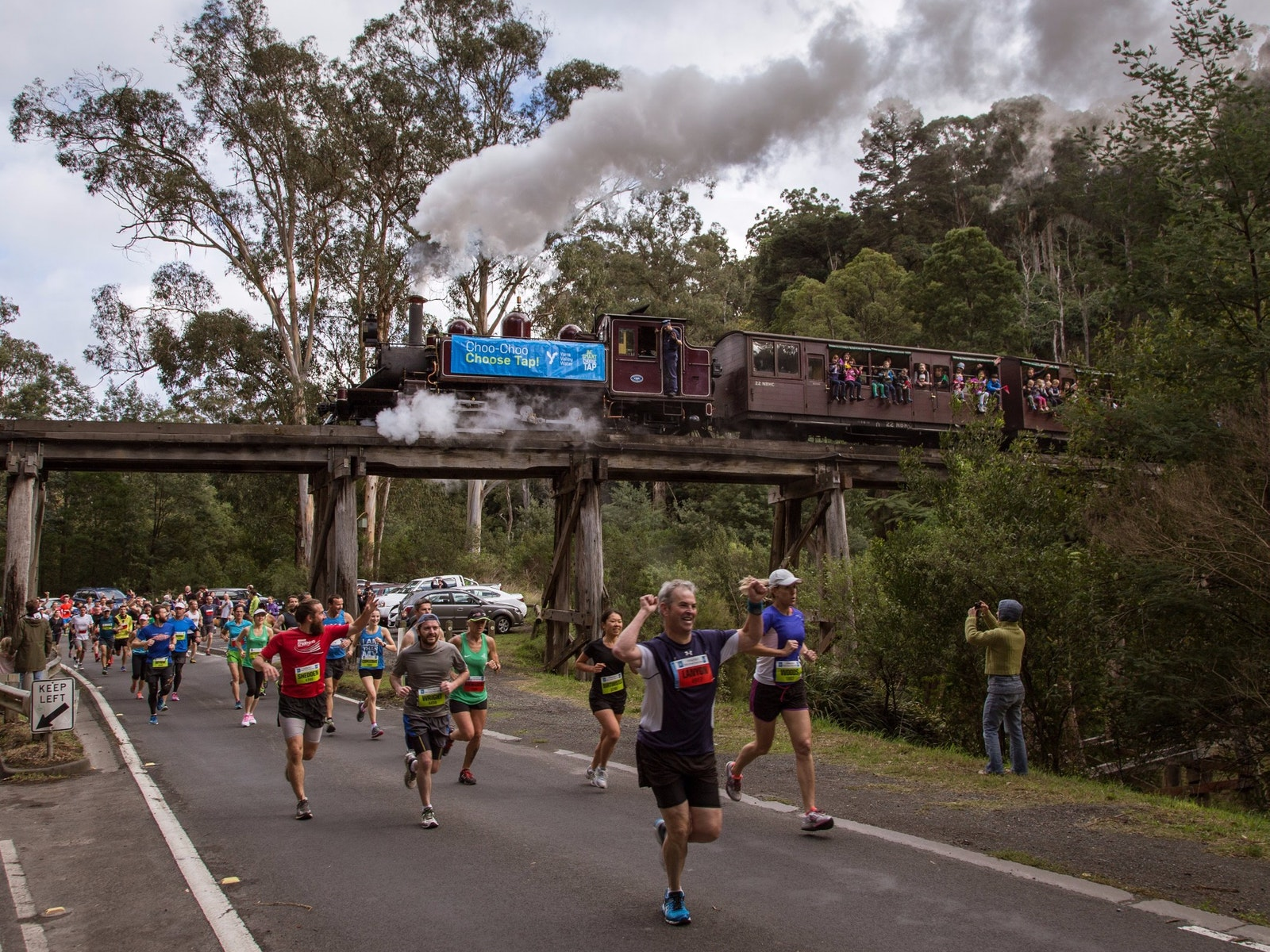 Great Train Race competitors run against Puffing Billy