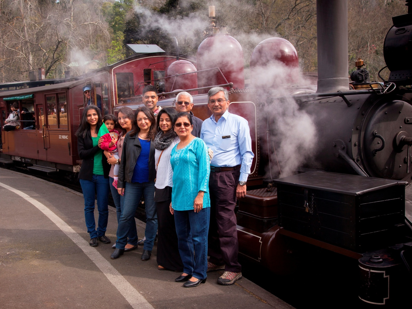 International family at next to Puffing Billy locomotive