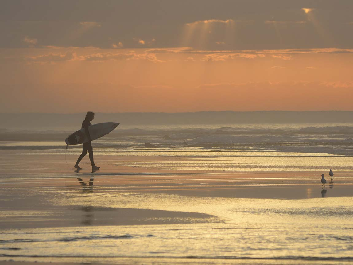 Surfer at Thirteenth Beach, Barwon heads, Geelong and the Bellarine, Victoria, Australia